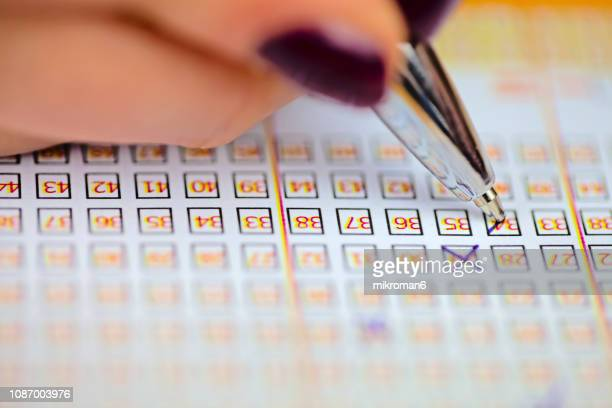 pen markings on lottery ticket. filled in lottery ticket - lotterytickets stock pictures, royalty-free photos & images