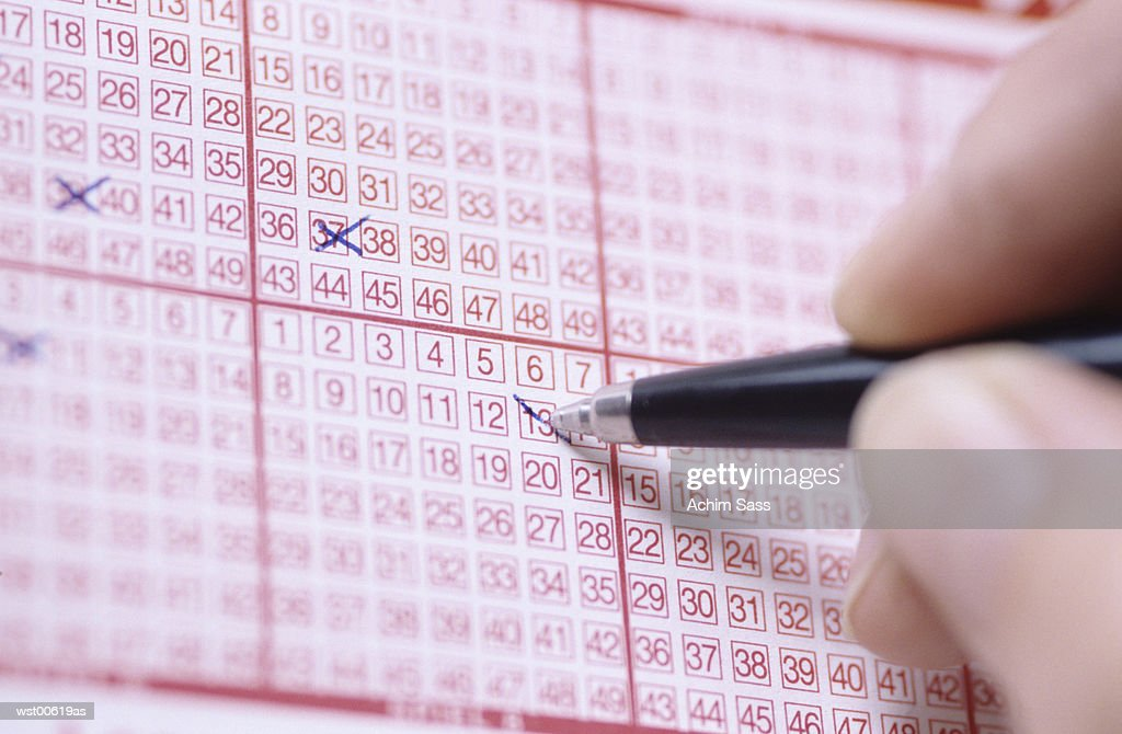 Pen markings on lottery ticket : Stock Photo