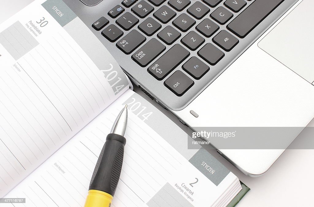 Pen On Calendar And Laptop Keyboard Stock Photo Getty Images