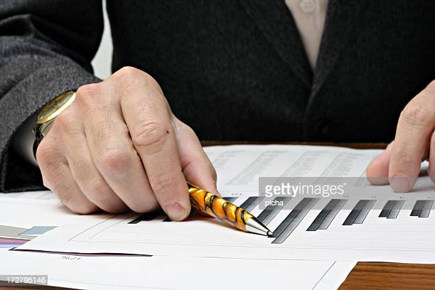 A pen pointing to financial results