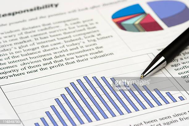 Pen resting on business document