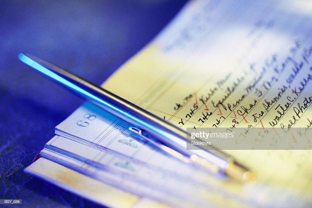 Pen resting on notepaper : Stock Photo