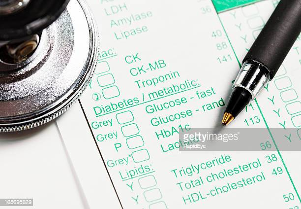 Pen, stethoscope on medical record concerning Diabetes and metabolism