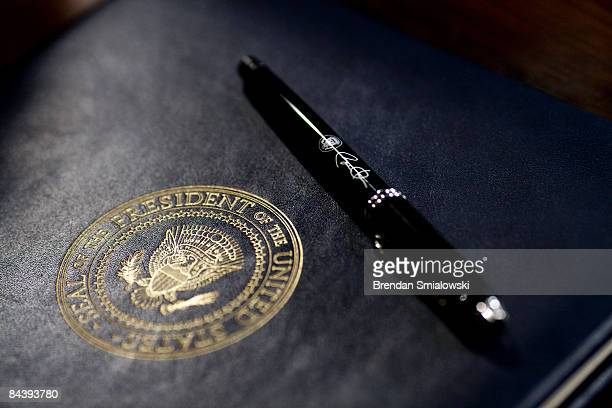 Pen used by U.S. President Barack Obama lies on an executive order prior to signing in the Eisenhower Executive Office Building January 21, 2009 in...