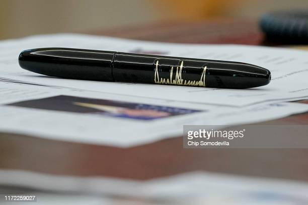 Pen with U.S. President Donald Trump's signature printed on the side sits on the Resolute Desk following a briefing about Hurricane Dorian in the...