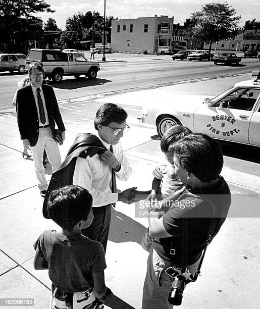 61987 Pena is greeted bv Richard Espinoza outside of Pena's precinct voting place at 26th and Federal before Pena votes Espinoza brought his two...