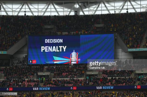 A penalty award VAR decision is displayed on the scorebaord during the FA Cup Semi Final match between Watford and Wolverhampton Wanderers at Wembley...