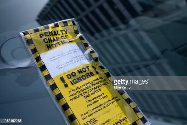 Penalty charge notice or PCN on the windscreen of a car on 30th March 2021 in Birmingham, United Kingdom. Penalty charge notices or fixed penalty...