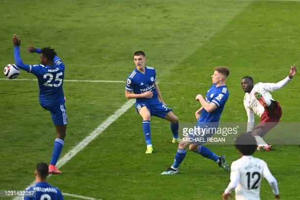 Penalty is given after Leicester City's Nigerian midfielder Wilfred Ndidi uses his hand to stop a shot from Arsenal's French-born Ivorian midfielder...
