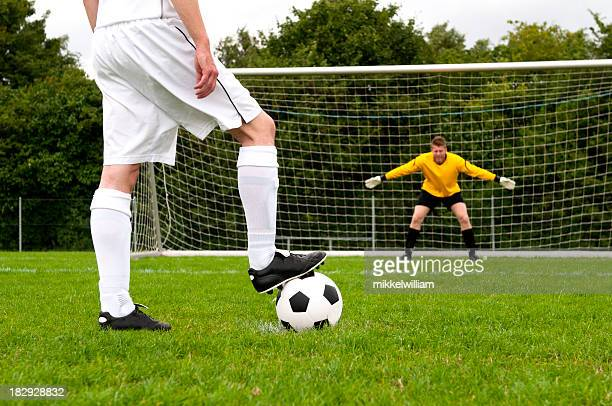 Penalty kick and soccer player is ready to kick football