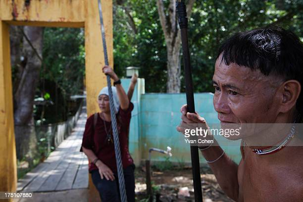 Penan tribesman Bala stands close to small suspension bridge in the village of Long Napir in Sarawak He is holding a traditional spear and blow pipe...