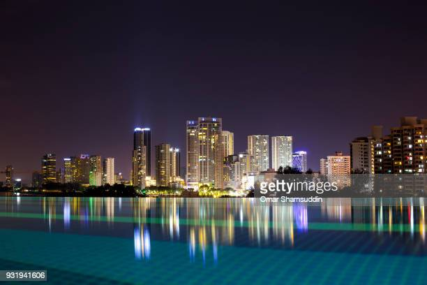 penang skyline at night with reflection on the water - omar shamsuddin stock pictures, royalty-free photos & images