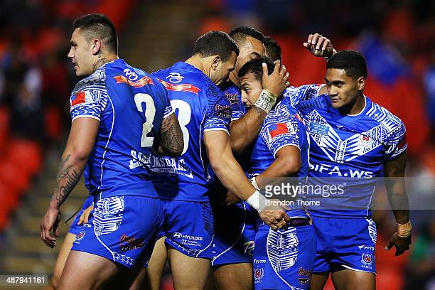 Penani Manumaleali'i of Samoa celebrates with team mates after scoring a try during the International Test Match between Fiji and Samoa at...