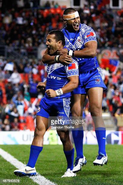 Penani Manumaleal'l of Samoa celebrates with team mate Dominique Peyroux after scoring a try during the International Test Match between Fiji and...