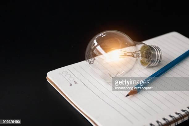 Pencil and Light bulb ,book