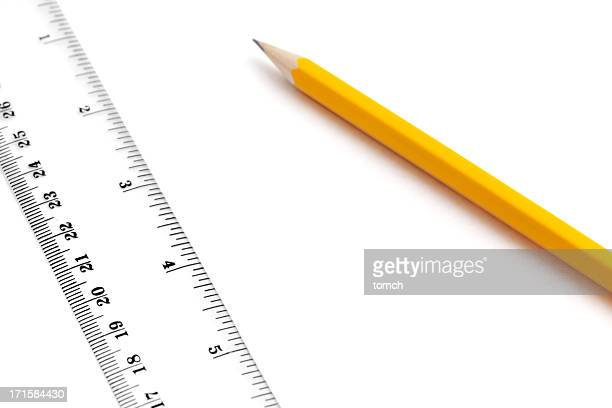 Pencil and ruler on white background