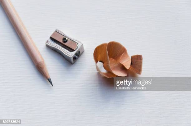 Pencil and sharpener with shavings