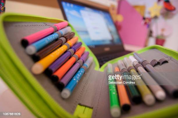pencil box against the computer,school theme, learning objects traditional, romania - pencil case stock pictures, royalty-free photos & images
