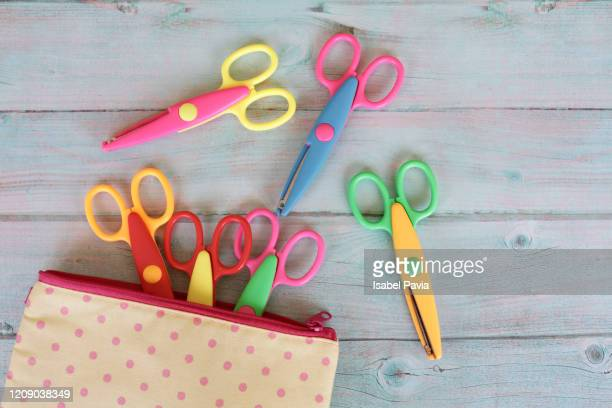 pencil case and multi colored scissors on table - pencil case stock pictures, royalty-free photos & images