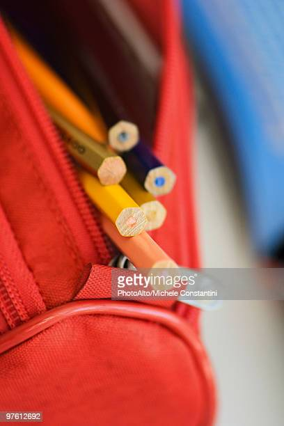 Pencil case filled with colored pencils, close-up