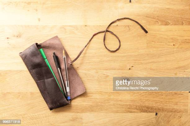 pencil case with three pens - pencil case stock pictures, royalty-free photos & images