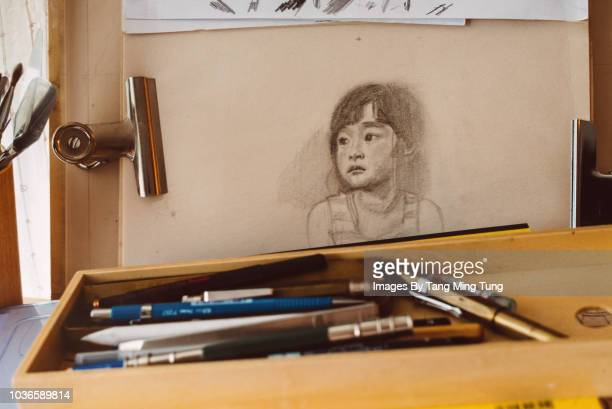 pencil drawing of a little girl's portrait on an easel. - pencil drawing stock pictures, royalty-free photos & images