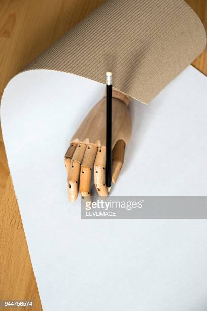 Pencil In A Wooden Hand.