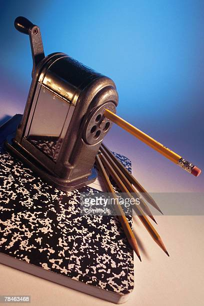 Pencil sharpener with pencils and notebook