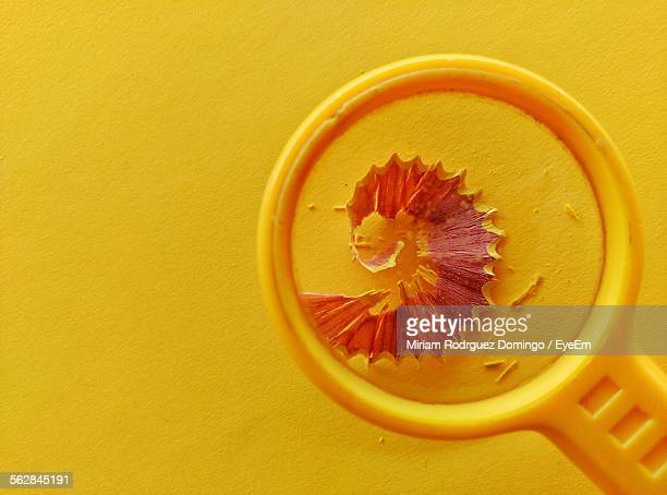 Pencil Shavings Being Magnified By Magnifying Glass