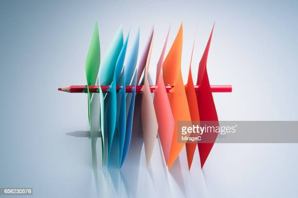 Pencil Threading Colorful Papers, Productive Concept