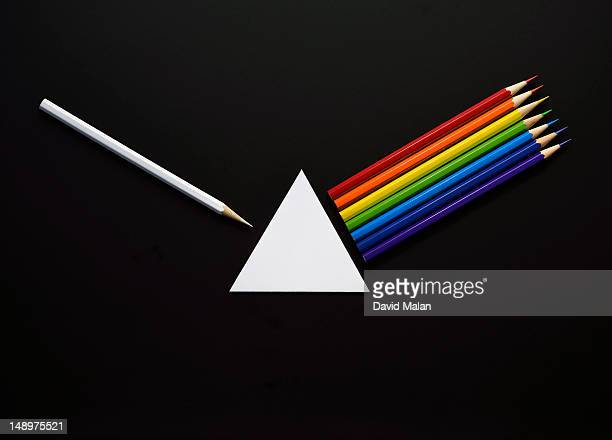 Pencils and paper forming a prisim and spectrum