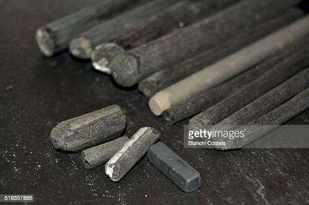 Pencils charcoals on black background