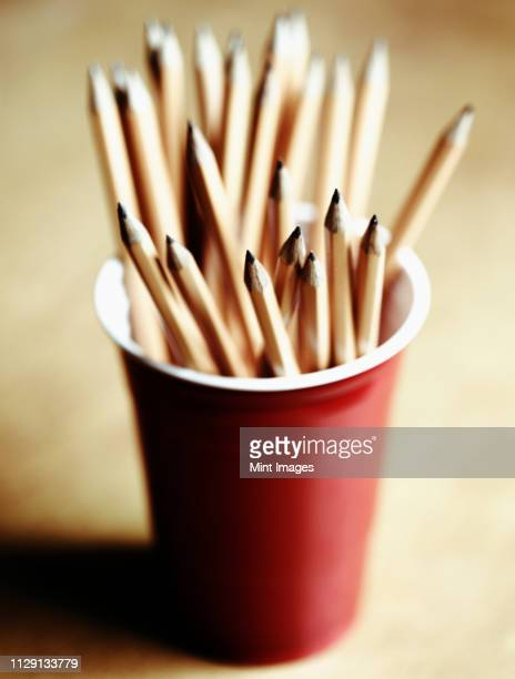pencils in a red cup - 尖っている ストックフォトと画像