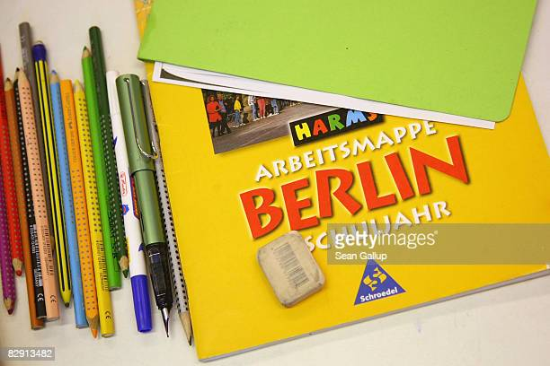 Pencils pens and a Berlin school notebook lie on a child's desk in a fourthgrade classroom in the elementary school at the John F Kennedy Schule...