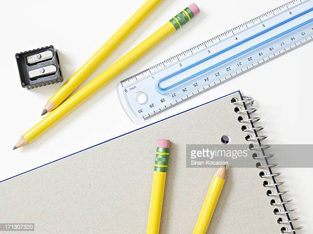 Pencils, ruler and notebook