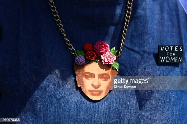A pendant depicting a suffragette hangs from a women's neck as she prepare to take part in mass participation artwork 'Processions' to celebrate one...