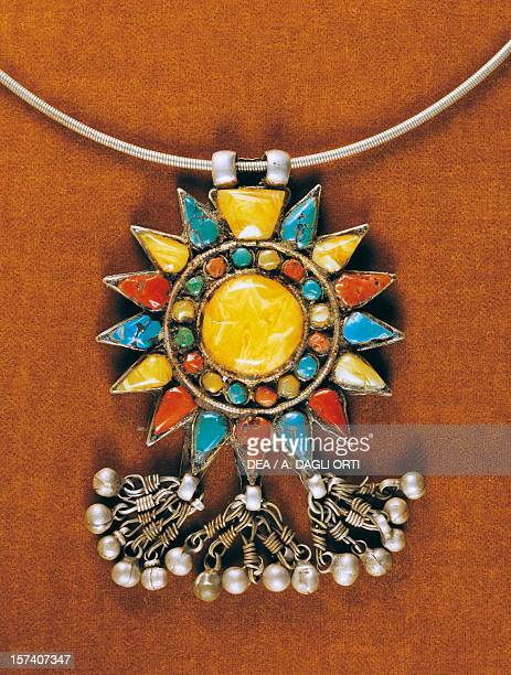 Pendant in turquoise coral and amber Nepal 19th century