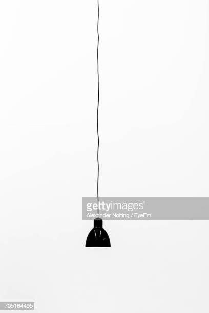 pendant light hanging against white background - pendant light stock pictures, royalty-free photos & images
