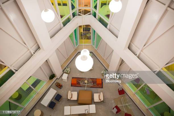 Pendant lights hang above a shared space at the WeWork Cos. 32nd Milestone co-working space in Gurugram, India, on Monday, Feb. 18, 2019. The New...