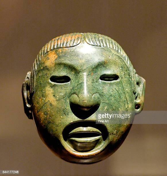 Pendantmask associated with the rituals of Aztec god Xipe Totec Stone Mexico Valley 15th centurybefore 1521 Height 109 cm Located in Musee du Louvre...