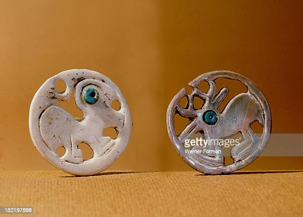 Pendants, one with a bird design, one with a deer, Made from abalone shell imported from the Pacific Coast. The eyes are turquoise beads. USA...