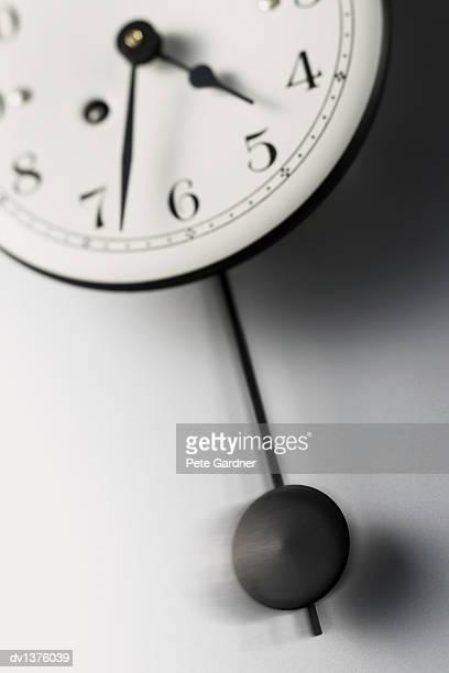 Pendulum Swinging From a Clock