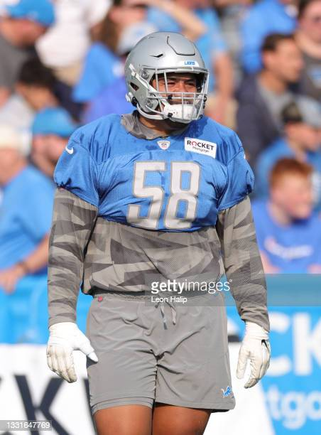 Penei Sewell of the Detroit Lions looks across the field during Training Camp on July 31, 2021 in Allen Park, Michigan.