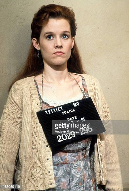 Penelope Ann Miller gets booked in a scene from the film 'The Gun In Betty Lou's Handbag' 1992