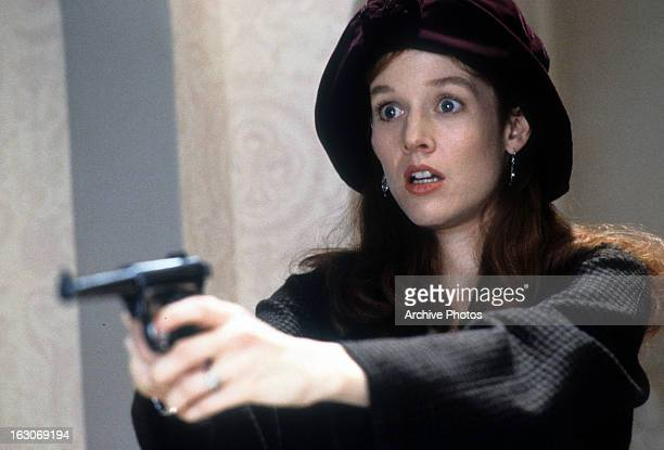 Penelope Ann Miller points a gun in a scene from the film 'The Gun In Betty Lou's Handbag' 1992