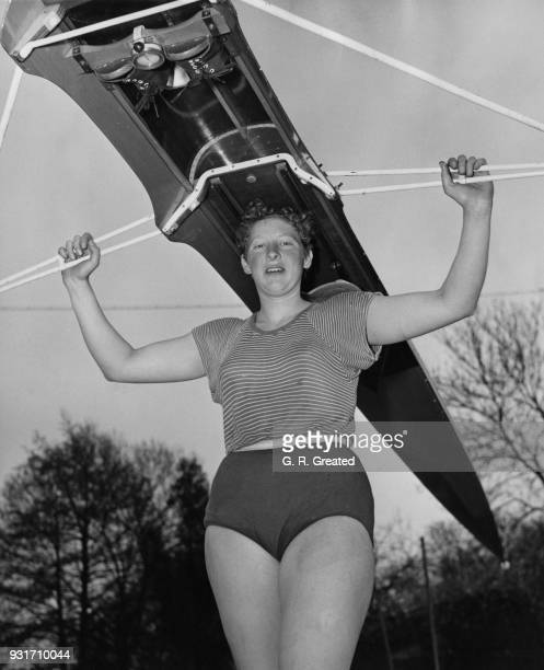 Penelope Chuter the British ladies' sculling champion and a secretary at the Bank of England during a training session at the Laleham Skiff and...