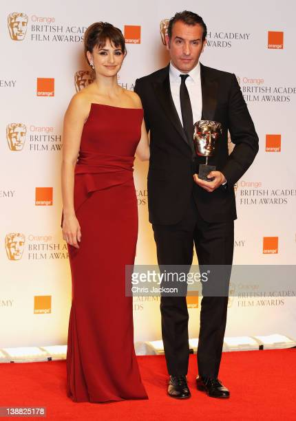 Penelope Cruz and Jean Dujardin pose in the press room with his Best Actor award during the Orange British Academy Film Awards 2012 at the Royal...