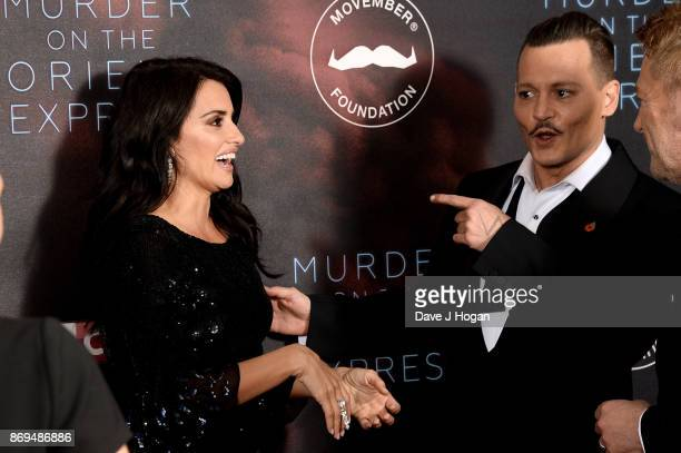Penelope Cruz and Johnny Depp attend the 'Murder On The Orient Express' World Premiere at Royal Albert Hall on November 2 2017 in London England