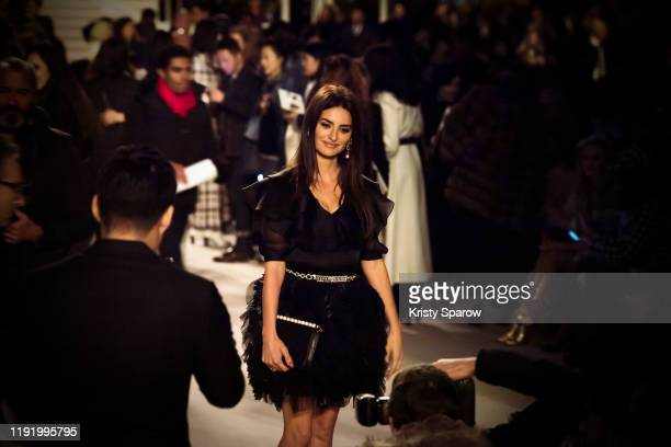 Penelope Cruz is seen arriving to the front row of the Chanel Metiers d'Art 2019-2020 show at Le Grand Palais on December 04, 2019 in Paris, France.