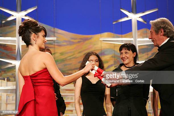 Penelope Cruz one of the actresses from the female cast of 'Volver' that received the Best Female Actress award jointly receives the award from Jean...